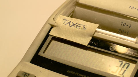 antique led calculator detail with ribbon paper, footage to represent business Live Action