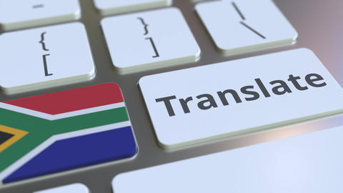 TRANSLATE text and flag of South Africa on the buttons on the computer keyboard Footage