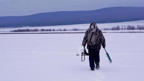 Fisherman on ice fishing. Winter ice fishing Live Action
