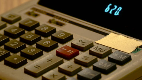 hands detail on ancient led calculator, footage to represent business and Footage