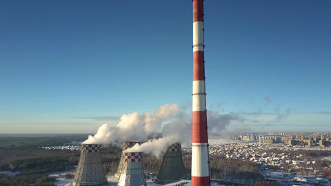 aerial view chimney and cooling towers against town and sky Footage