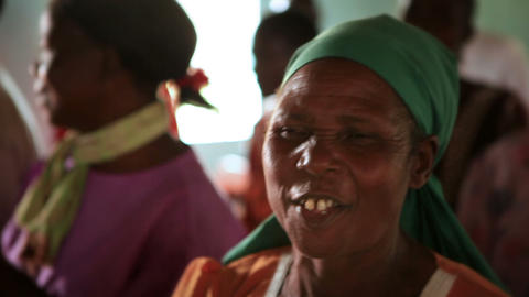 KENYA-C.2012 A woman wearing a head scarf sings and dances during worship in Ken Live Action