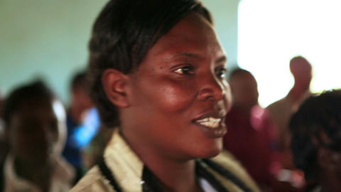 KENYA-C.2012 Woman sings, sways, and worships with her friends and family in Ken Live Action