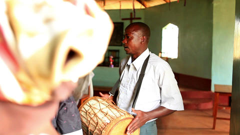 KENYA-C.2012 A man drums accompaniment for a singing congregation in Kenya, Afri Footage