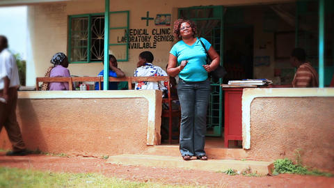 KENYA-C.2012 A woman dances for the camera outside a medical clinic in Kenya, Af Footage