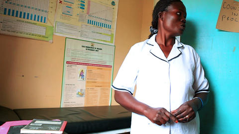 KENYA-C.2012 A doctor gives a tour of a medical clinic's examination room in Ken Footage