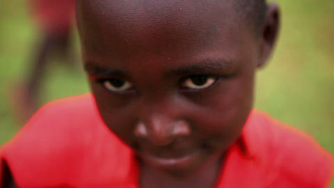 KENYA-C. 2012 A young boy smiles shyly and looks down in Kenya, Africa c.2012 Live Action