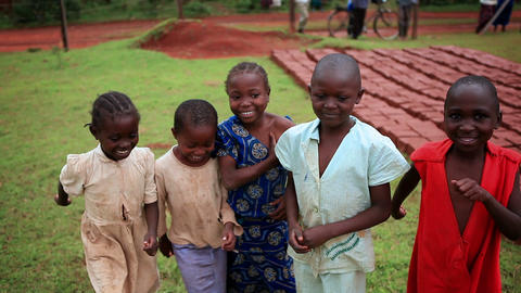 KENYA-C.2012 Five cute kids laugh and march in place in Kenya, Africa c.2012 Live Action