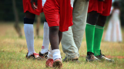 Close up of legs and feet of young football players Footage