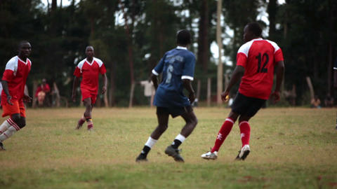 KENYA-C.2012 Two teams of African boys play an intense game of football in Kenya Live Action