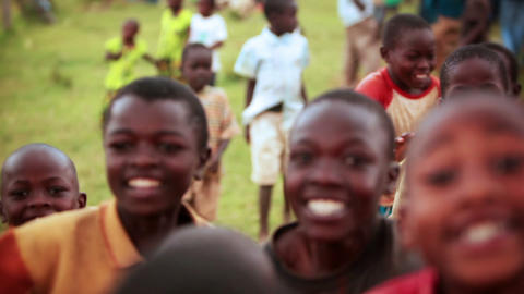 KENYA-C.2012 Young boys jumping for the camera on a football field in Kenya, Aft Footage