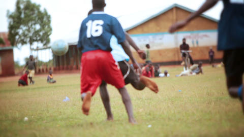 KENYA-C.2012 Football players fight for the ball near the edge of the field in K Footage