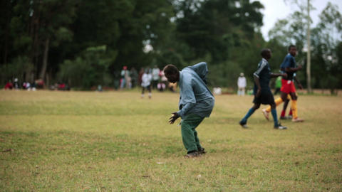 KENYA-C.2012 A man celebrates in the middle of a football field in Kenya, Africa Footage