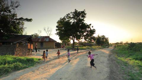 Children playing in dirt roads in Kenya Footage