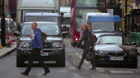 Pedestrians crossing a street in London Footage