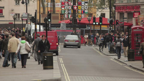 People and traffic on a busy street in London Footage