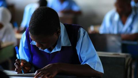 Student working in school in Kenya Footage