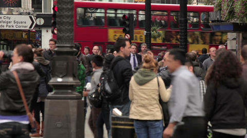LONDON - OCTOBER 7: Unidentified people and passing buses on Piccadilly on Octob Footage
