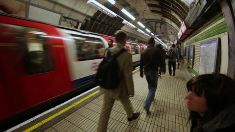 LONDON - OCTOBER 6: People walking next to the tube in an underground station on Footage