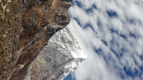 Vertical shot of Time-lapse of clouds passing over rocky Himalayan peaks Footage