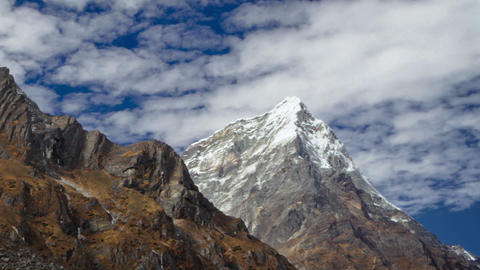 Time-lapse of rocky Himalayan peaks and passing clouds. Cropped Footage