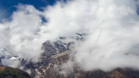 Time-lapse of clouds moving around Himalayan mountains. Cropped Footage