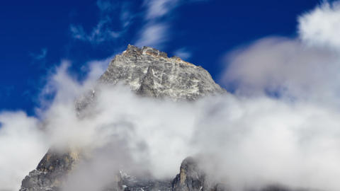 Time-lapse of clouds swirling around a Himalayan peak. Cropped Footage
