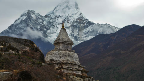 Panning shot of Time-lapse of a buddhist stupa with Ama Dablam peak in the backg Footage