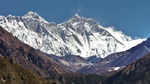 Panning shot of Time-lapse of Everest and surrounding peaks and people on a fore Footage