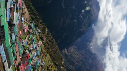 Vertical shot of Time-lapse of a colorful village on a Himalayan mountainside Footage