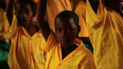 Close up of a boy raising his hand at school in Kenya Footage