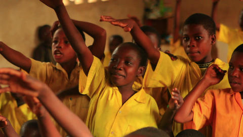 Close up of a student raising his hand in school in Kenya Footage