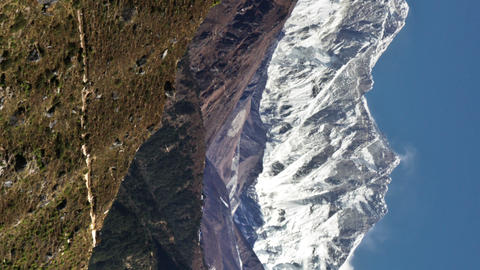 Vertical shot of Time-lapse of the tip of Everest and surrounding peaks and trek Footage