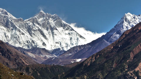 Panning shot of Time-lapse of the tip of Everest and surrounding peaks and trekk Footage