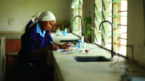 School girls doing chemistry in Kenya Footage