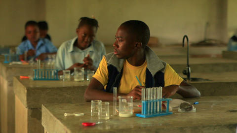 Student doing chemistry in Kenya Footage