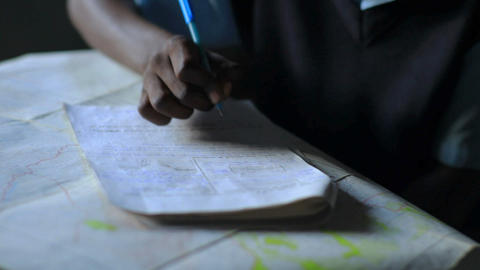 Students taking an exam in school in a village in Kenya Footage