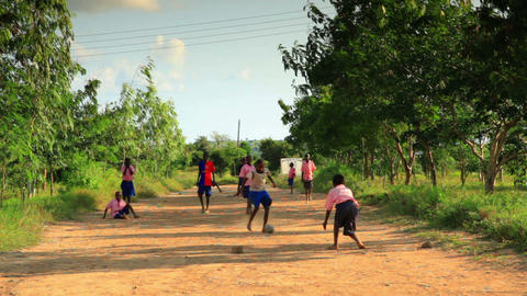 Boys playing during recess at school in a village in Kenya Footage