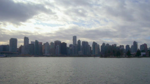 Long shot of Vancouver skyline from across water Footage