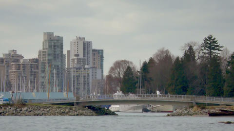 Small bridge blocks entrance to Vancouver harbor filled with boats Footage