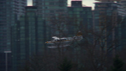 Water plane flying in and landing in Vancouver harbor Footage