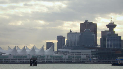 Medium shot of Vancouver skyline from across harbor Footage