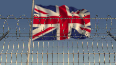Defocused waving flag of Great Britain behind barbed wire fence. Loopable 3D Live Action