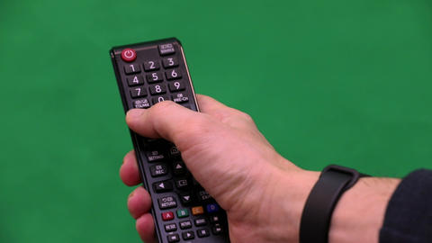Men's hand. Remote control. Right hand. Green screen. Press the button Footage