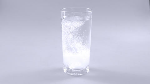 Effervescent tablets dissolving in water slow motion Footage