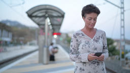 Mature Beautiful Tourist Woman Using Phone While Waiting At The Train Station Footage
