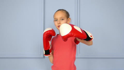 Teenager girl in boxing gloves training fight slow motion. Boxing training Live Action