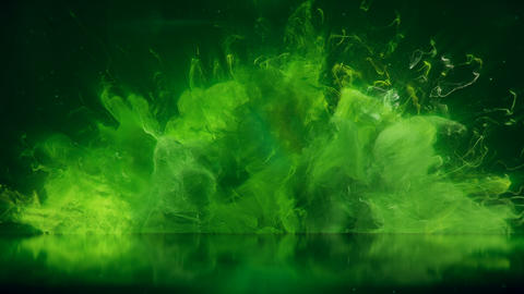Green Color Burst colorful smoke explosion fluid particles reflection background Animation