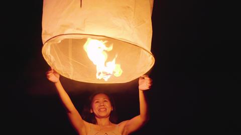 Asian Woman Releasing A Sky Lantern GIF