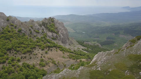 Aerial. Flying over Mountains, rocks and forests. Amazing view of Crimea Footage
